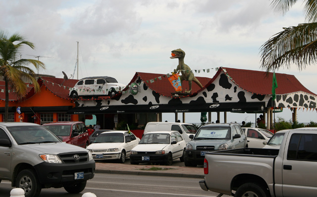 Dinosaur on a shoreside bar in Oranjestad
