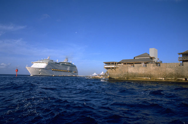 A cruise ship passing an ancient fort in Curacao