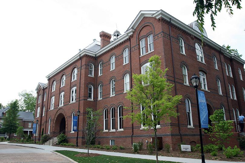 Students enter the Rockefeller Fine Arts Building.