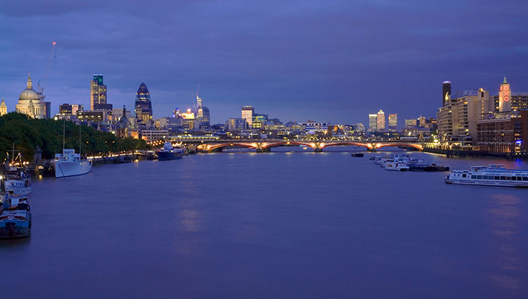 London skyline seen from the Thames River in the evening