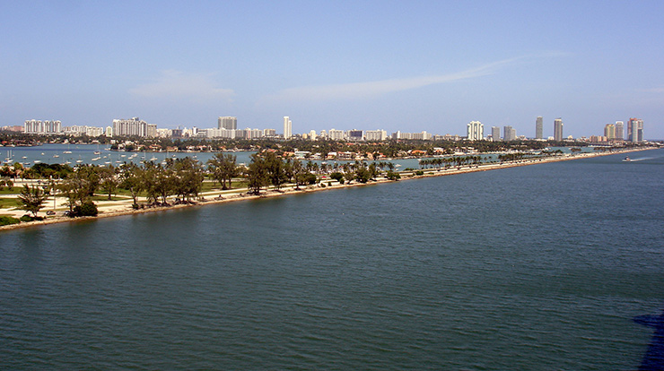 A long beach lining Miami Ship Channel