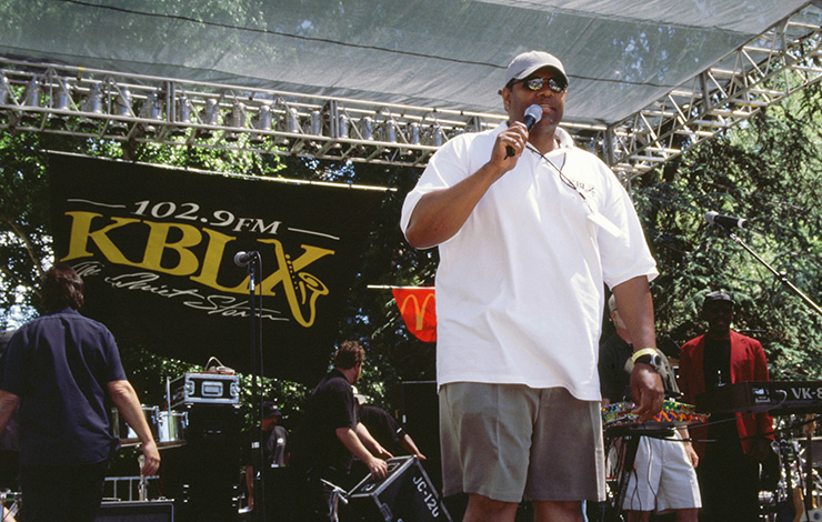 Kevin Brown of KBLX radio station speaking at the Stone Soul Picnic