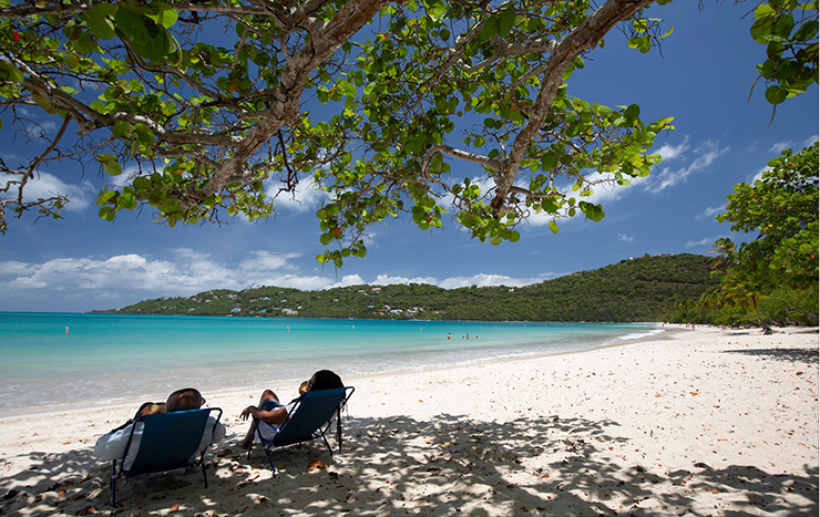 A couple reclining on Magens Bay Beach